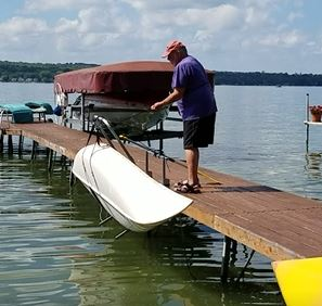 Image of Canoe being lifted in Canoe Dock Lift and Storage Rack